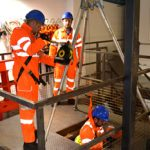 What is the difference between a confined space and a high risk environment?